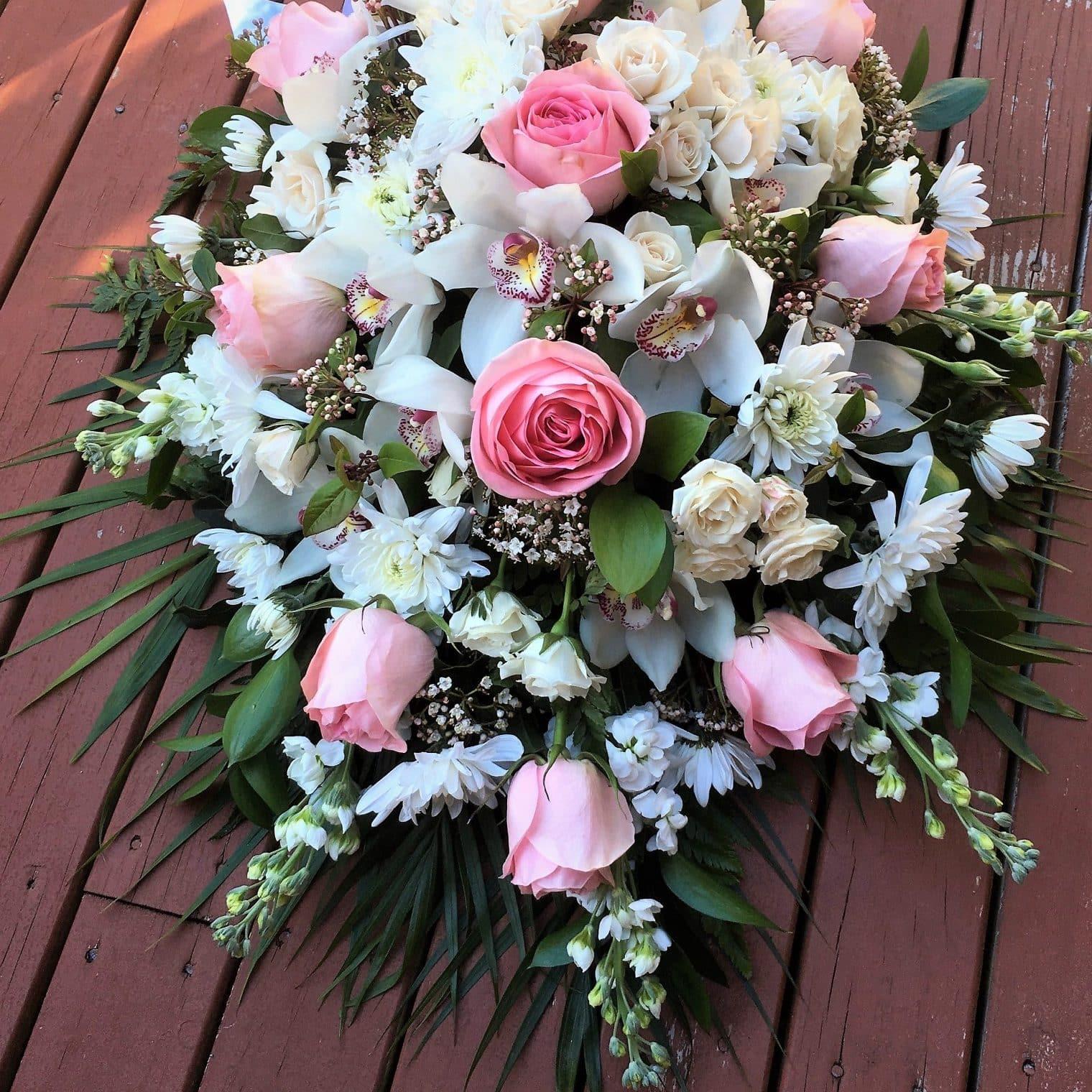 Sympathy flower casket spray harbour rose florist gorgeous pastel and white flower arrangement for the casket izmirmasajfo