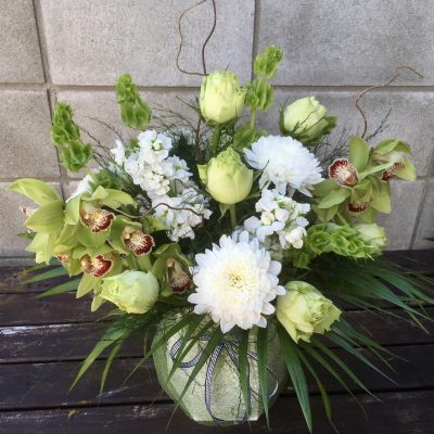 Sympathy flowers in water box