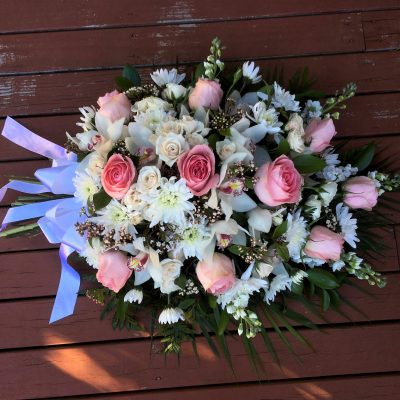 Gorgeous pastel and white flower arrangement for the casket