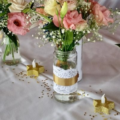 Small wedding reception flowers in mason jars