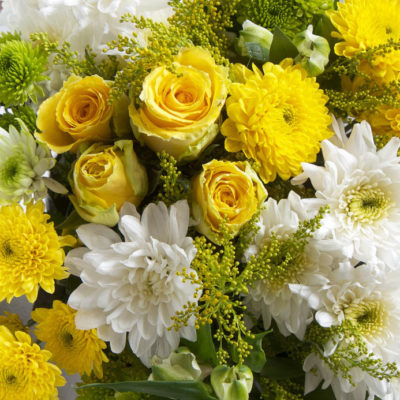 Yellow and white roses, chrysanthemums, alstromeria and solidago.