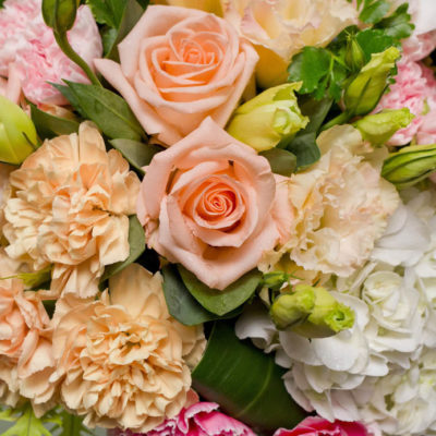 Bouquet of pastel peach, pink and white flowers