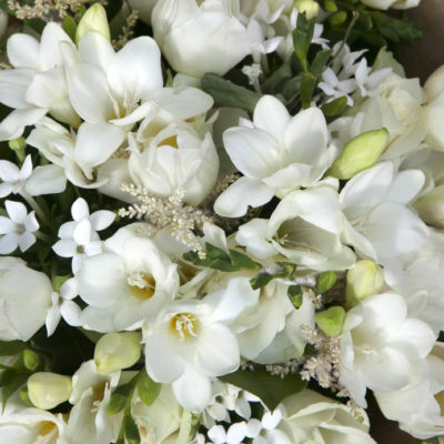 we Bouquet of white flowers - roses,freesias, tulips and jasmine.