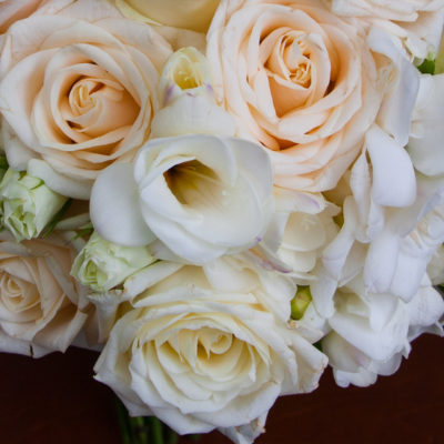 Soft ivory and white flowers in brides's bouquet