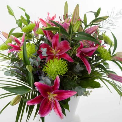 Hot pink lilies with lime green chrysanthemums and foliage