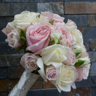 Bridesmaid's bouquet of blush pink and white roses