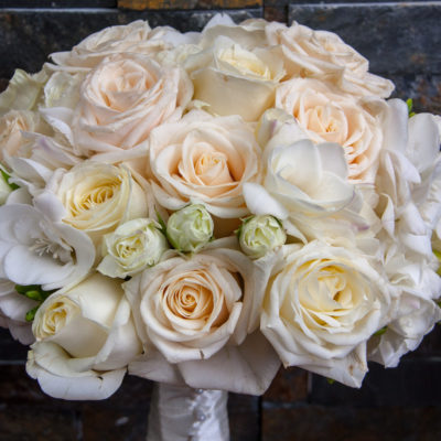 Ivory and white bridal bouquet of Vendela and Avalanche roses,white spray and freesias