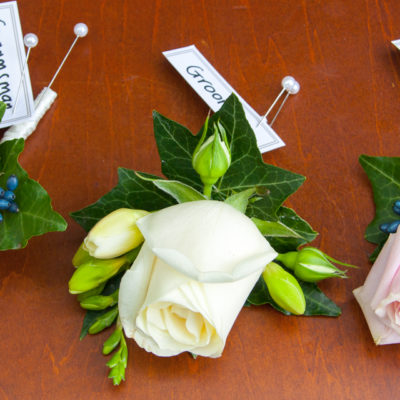 Buttonholes for groom, groomsman and father of the bride