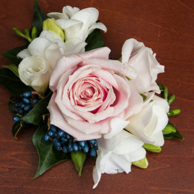 Wedding cake flower topper with blush pink rose, freesias, white spray roses and Viburnum berries.