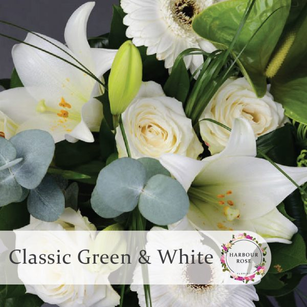 White lilies, roses and gerberas with green anthuriums and chrysanthemums. foliage