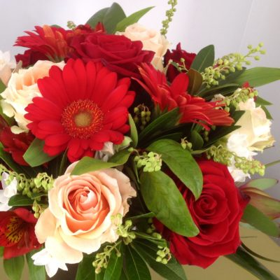 Bouquet of roses, gerberas and alstromeria with foliage.