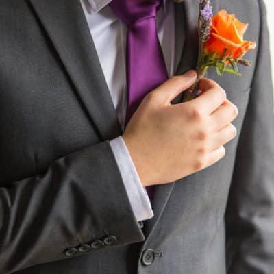 Groom with orange rose buttonhole