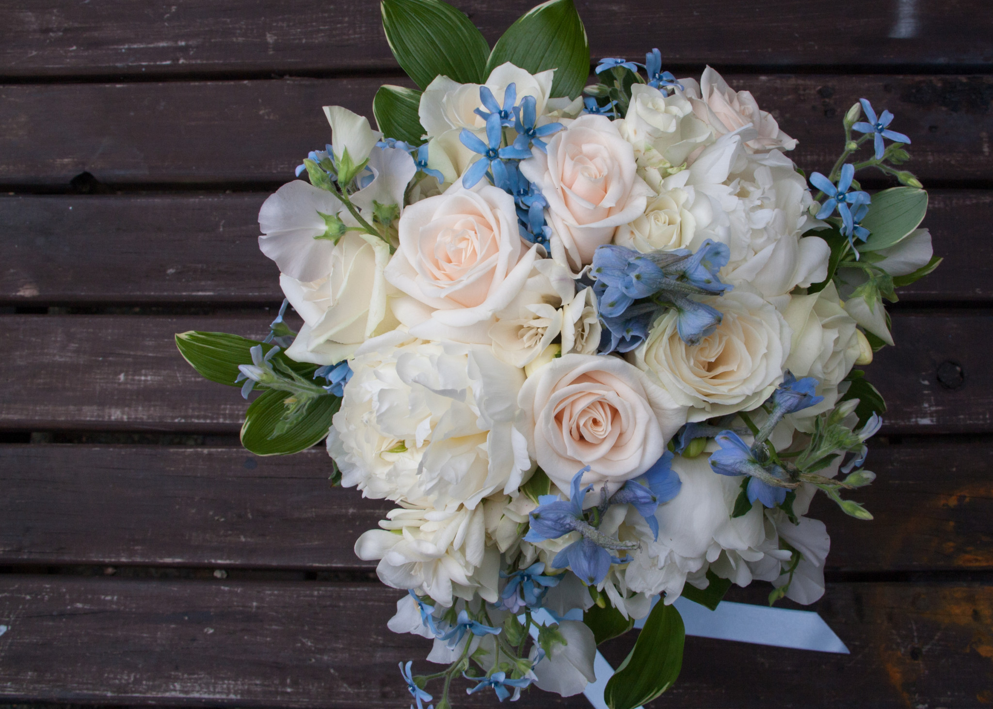 Showing bridal bouquet with pale blue flowers