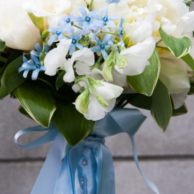 Showing the ribbon wrapped stems of the bouquet