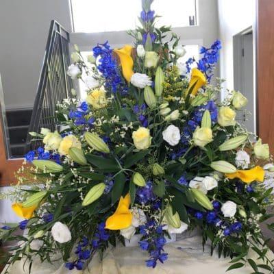 Funeral pedestal flowers in vase