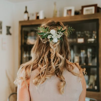 Bridesmaid's braided hair style and floral hair comb
