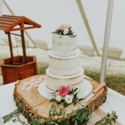 Cake topper and lower tier flowers for rustic theme wedding