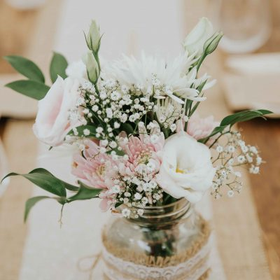 Wedding reception flowers in mason jars
