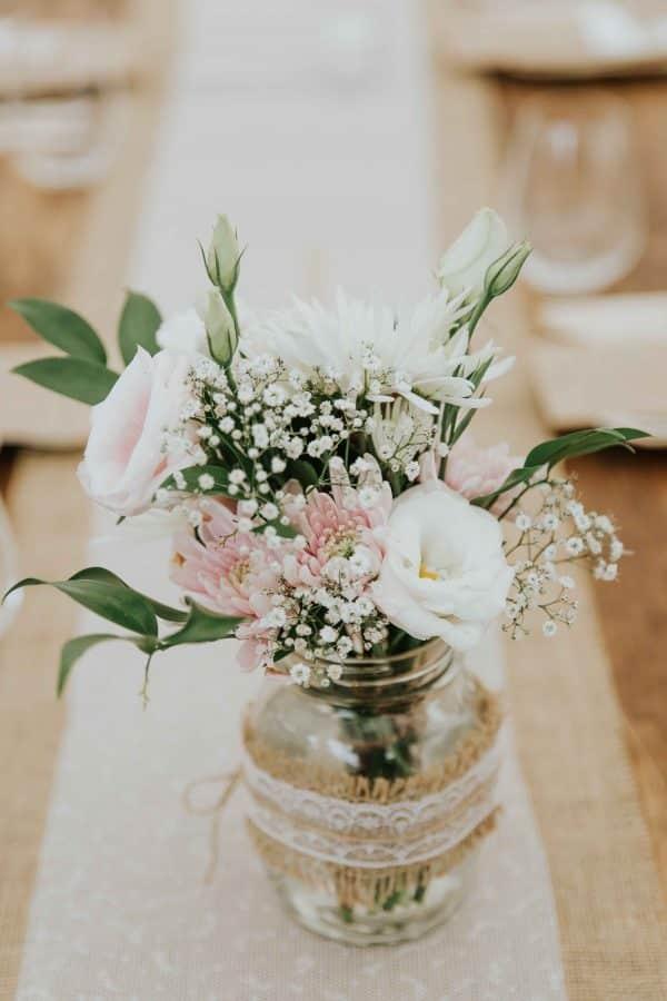 Wedding reception flowers in mason jars