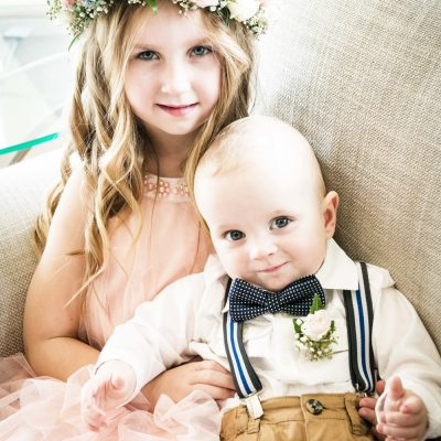 Floral crown for flower girl and cute buttonhole for little boy