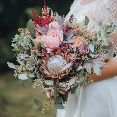 Gorgeous bridal bouquet with King protea for autumn wedding