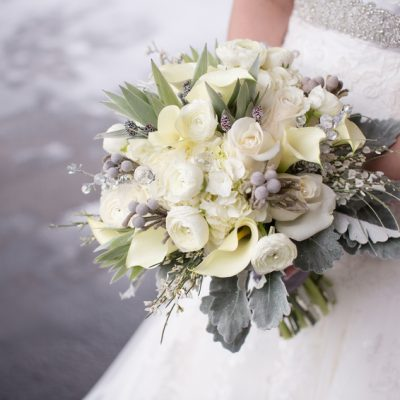 Bouquet in shades of white and cream flowers, with crystal embellishments .