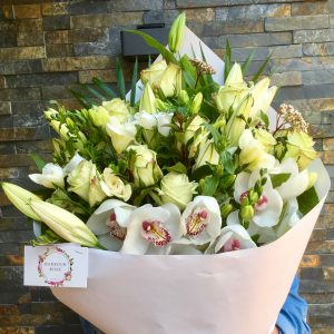 Large lush Sympathy flower sheaf as condolence flowers.