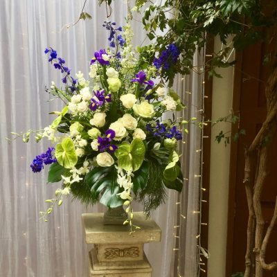 Close up of wedding florals in urn