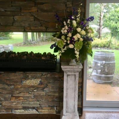 Wedding florals on pedestal