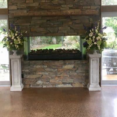 Ceremony florals on pedestals