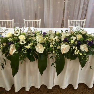 Long bridal table flower arrangement