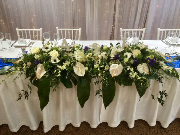 Long bridal table flower arrangement