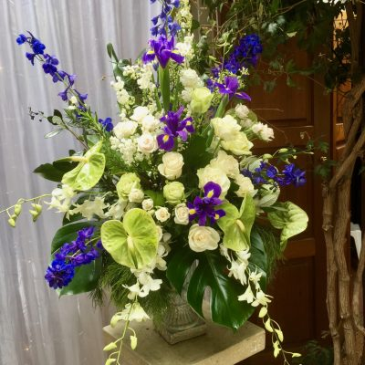 Large wedding florals in urn on pedestal