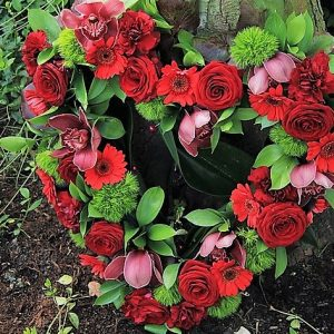 Red roses in a heart shaped sympathy arrangement