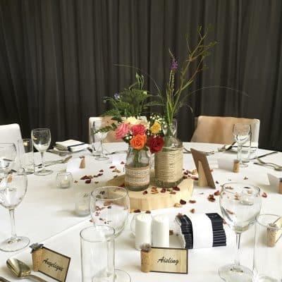 Rustic guest table flower arrangements