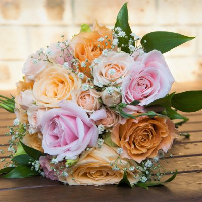 Soft peach and pinks in this bridesmaid's bouquet