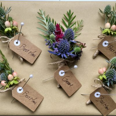 Rustic buttonholes for groom and groomsmen