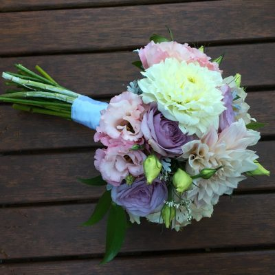 Soft and pastel flowers in a bridal bouquet