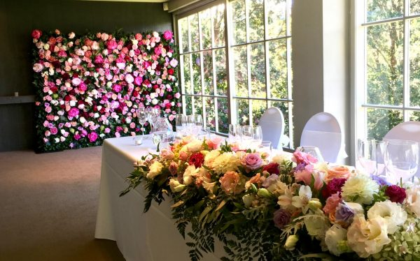 Pastel flowers and greenery for main table