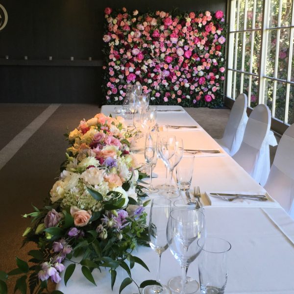 Bridal table flowers and flower wall .
