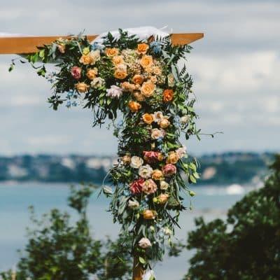 Wedding flower arch in soft pastel sahdes