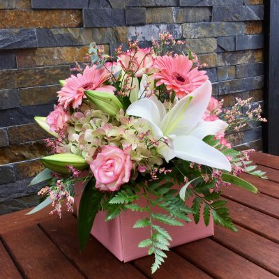 Flowers in pink posy box