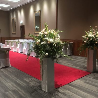 Large floral arrangements on pedestals