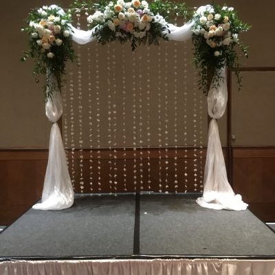 Wedding arch with florals and draping