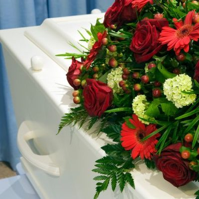 Red and green flower arrangement for the casket